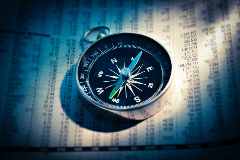 Stock market compass photo by G. Crescoli on Unsplash
