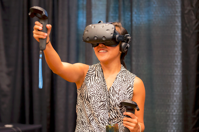 A participant tries the HTC Vive VR system at UCLA Anderson LeVRage